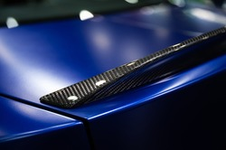 Detail of car rear spoiler carbon fiber texture finished