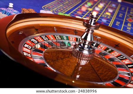 Detail of casino roulette with blue roulette table