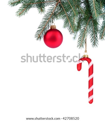 Detail of Christmas tree with red Christmas decorations in the corner on white background