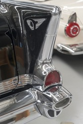 detail of chrome plated fin, rear lights and bumper  of vintage 50's car. shot at Wanaka, Otago, South Island, New Zealand