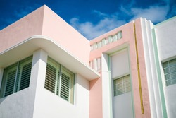 Detail of classic Art Deco architecture with pastel colors under blue sky in South Beach, Miami, Florida