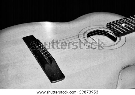 Detail of classic guitar. Old instrument background theme with retro film texture