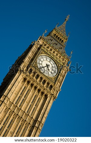 Detail of clock face of Big Ben, London against blue sky