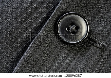 Detail of closeup of suit button on pin stripped cloth #128096387