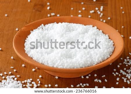 detail of coarse salt in the ceramic bowl