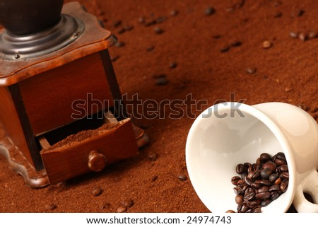 Detail of coffe grinder and cup - stock photo