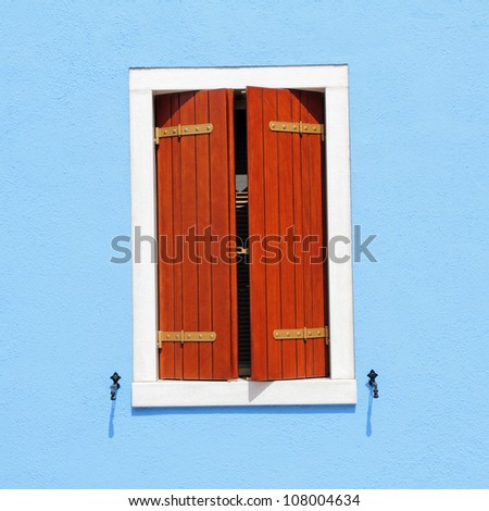 detail of colorful facade with window with ajar shutters, Burano, Venice, Italy, Europe