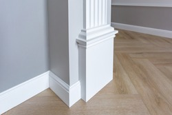 Detail of corner flooring with intricate crown molding.