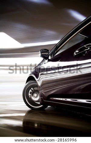 Detail of dark colored car turning fast with many lights - stock photo