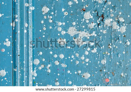 Detail of decaying wood door with paint drops
