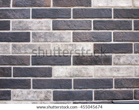 Detail of decorative brickwork closeup of gray and black bricks to be used as background #455045674