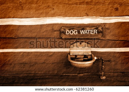 Detail of dog water sign and watering fountain