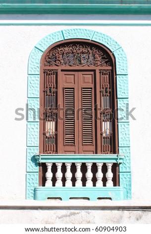 Detail of facade from vintage colonial building in Santiago de Cuba, Cuba