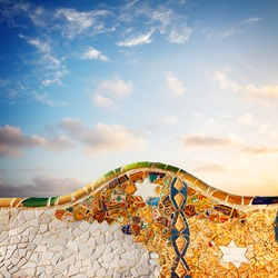 detail of famous colorful bench of park Guell at sunrise, Barcelona, Spain