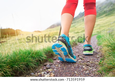Detail of feet during a mountain hike of a girl. #713591959