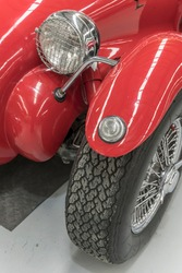 detail of fender and light of vintage red sport car. shot at Wanaka, Otago, South Island, New Zealand