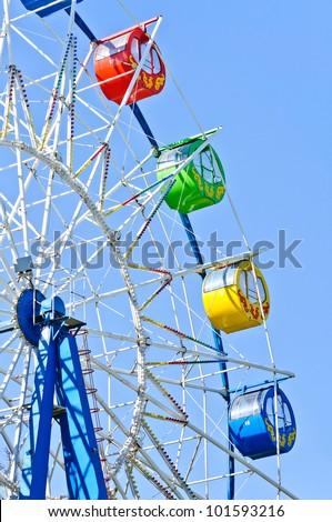Detail of Ferris wheel. Photo on blue sky background