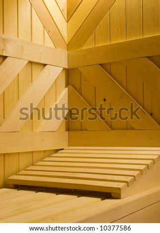 Detail of Finnish sauna. Wooden bench and pillow in it.