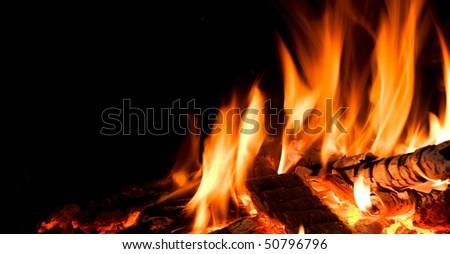 Detail of fire in open fireplace.
