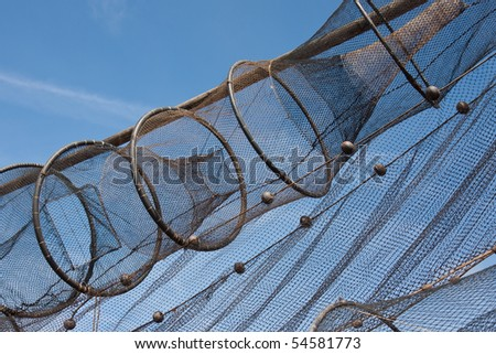 Detail of fishnet drying in the sun against the blue sky