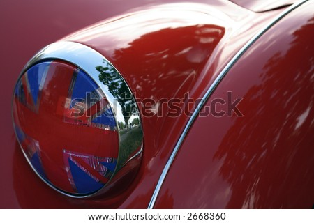 Detail of flag headlight cover on vintage British race car