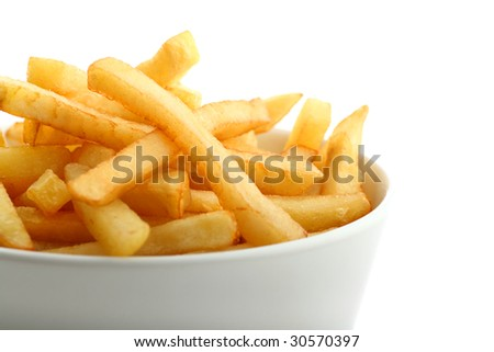 Detail of fresh golden french fries in ceramic bowl isolated on white