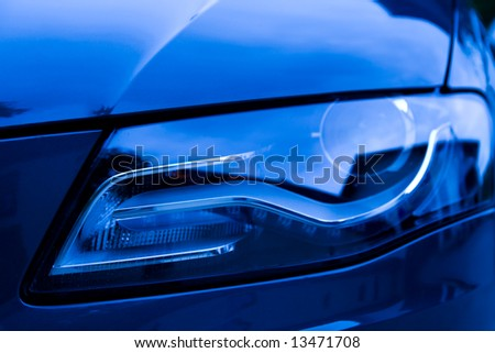 Detail of front light of a luxury car.