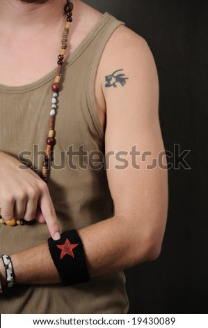 Detail of funky male arm with fish tattoo