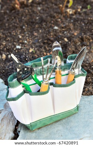 Detail of gardening tools in tool bag - outdoor - stock photo
