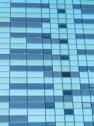 Detail of geometric shapes of skyscrapers in the city of Barcelona. Windows and glass. Textures