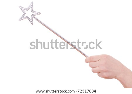 detail of girls arm and hand with magic wand - stock photo