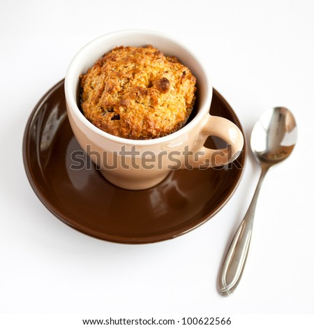 Detail of gluten free muffin in coffee cup on white background
