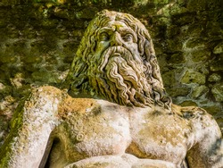 Detail of god Neptune colossal sculpture at famous Park of the Monsters, also named Sacred Grove, Bomarzo Gardens, province of Viterbo, Lazio, Italy