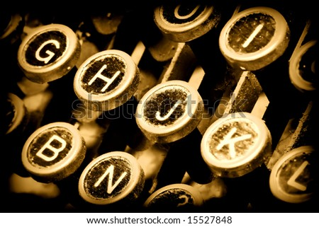 detail of golden typewriter, close up on keys
