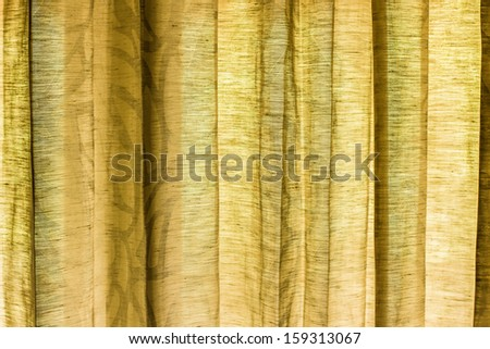 detail of green curtain as background