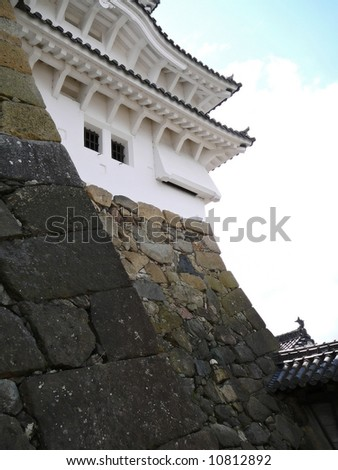 Detail of Himeji Castle, Japan. These sloped walls are meant to be insurmountable by Ninjas. The slits could be used to pour hot water on enemies.