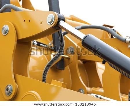 Detail of hydraulic bulldozer piston excavator arm construction machinery white background