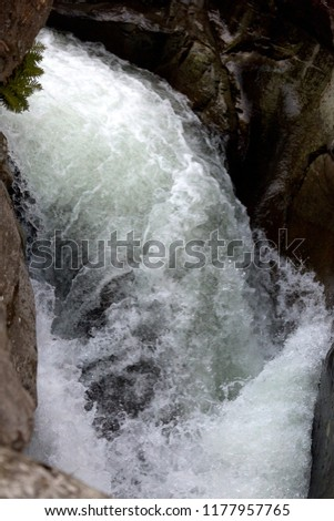 detail of impetuous torrent between the rocks #1177957765