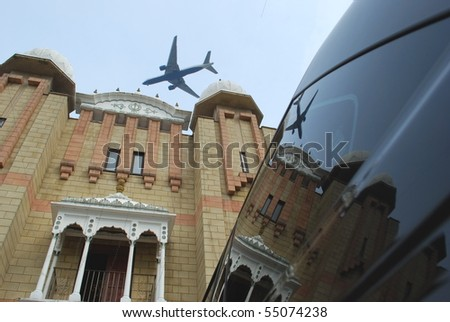 Detail of Indian temple and airplane landing to Heathrow Airport, London, UK