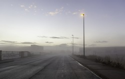 Detail of industrial zone in the city, on a fair day and fog in winter