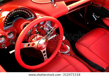Detail of interior red sports car steering wheel speedometer #312471518
