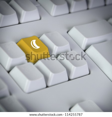 detail of keyboard with key showing moon - stock photo