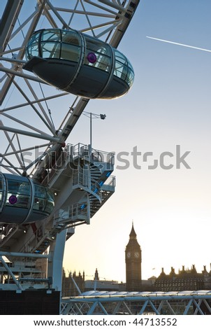 Detail of London Eye seen from Southbank. with Big Ben in the background.