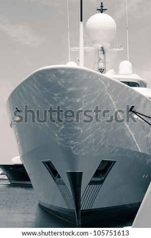 Detail of luxury yacht in port, digitally retouched and toned photo.