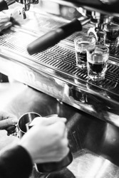 detail of making espresso coffee with machine bw black and white