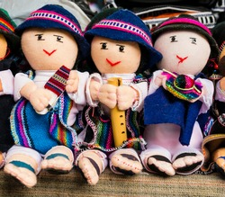 Detail of male rag dolls in traditional clothes playing musical instruments, Otavalo Market, Ecuador