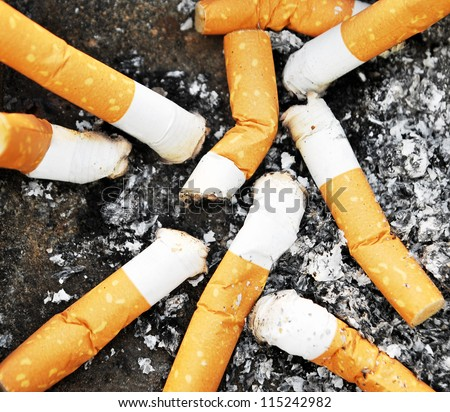 Detail of many dirty cigarettes