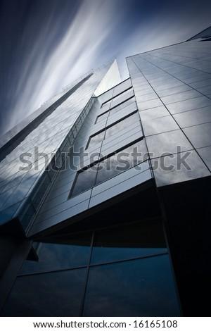 Detail of modern skyscraper. Psychedelic sky.