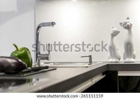 Detail of modern white kitchen clean interior design