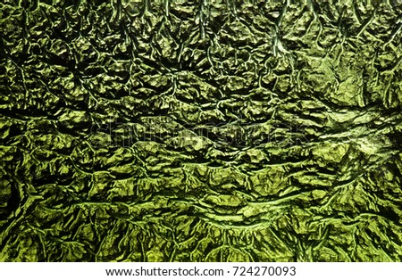 Detail of moldavite etched surface.  #724270093